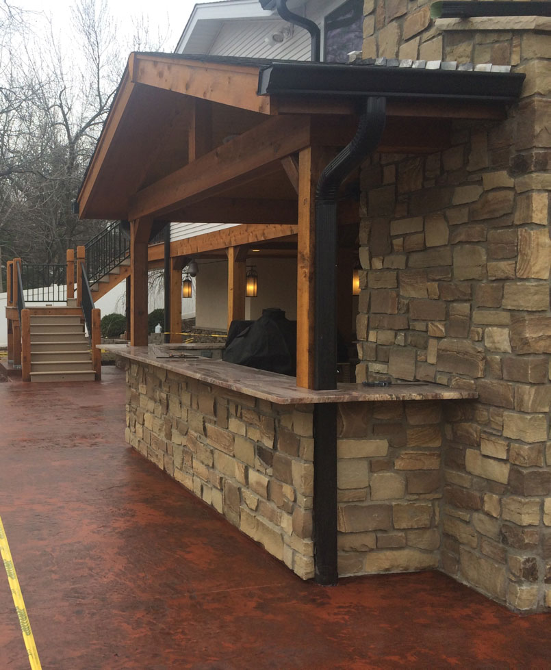 A patio installed by an outdoor kitchen in St. Louis