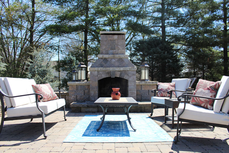 Chairs flank an outdoor fireplace in West County, St. Louis