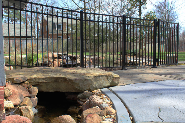 Natural stone and concrete pavers create a beautiful patio and water feature in St. Louis