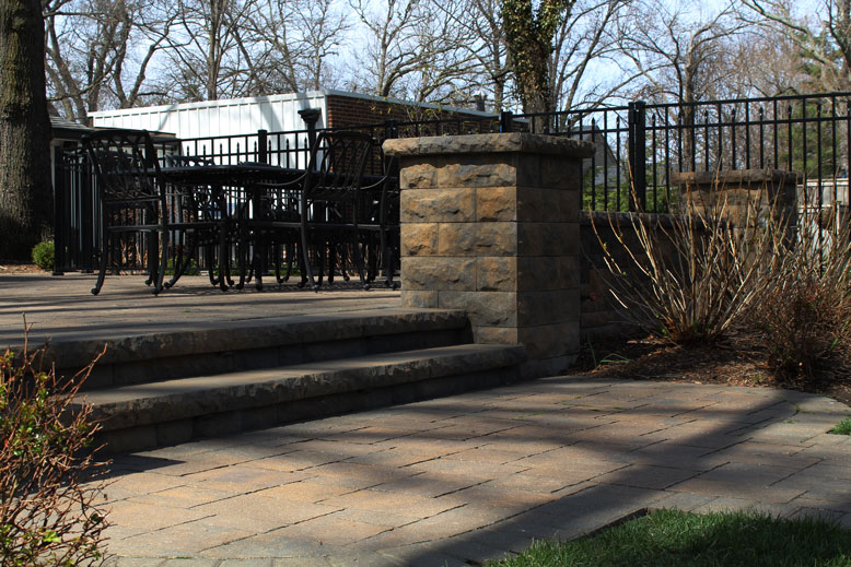 This raised wall surrounds a patio designed and built by Tennant Lawn Service