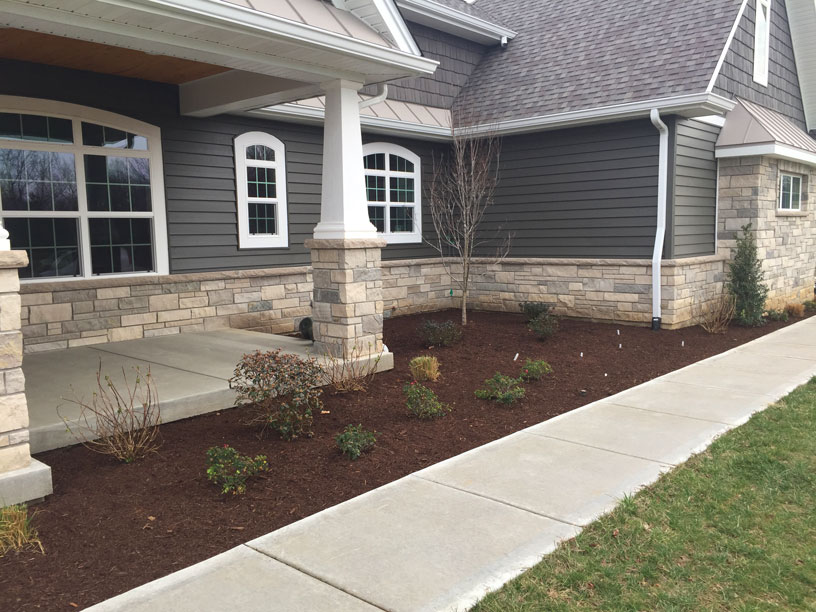 A front foundation garden designed by St. Louis' Tennant Lawn Service