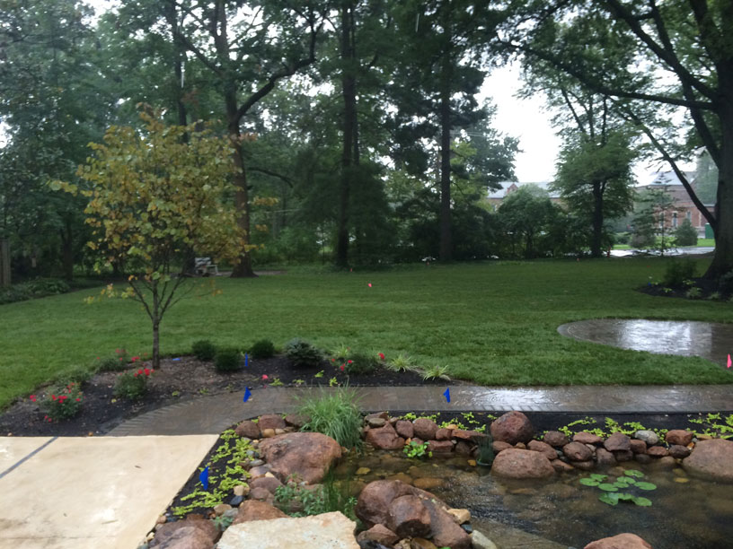 An image of a beautiful backyard water feature in St. Louis built and designed by Tennant Lawn Service