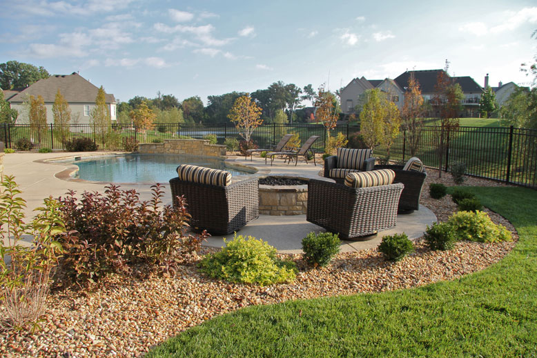 A patio and gardens surrounding a pool in St. Louis